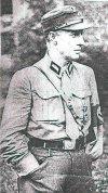 Петер фон Гейдебрек в кепи и форме штурмовика со Знаком заслуг на груди.