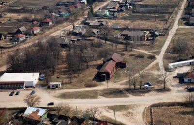 с. Ерахтур. Деревянный храм Святого Николы, где раньше было кладбище и могилы Качковых.