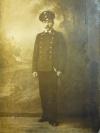 Николаев Матвей Иванович,стоит в форме с кортиком. (1915-1918 гг.).